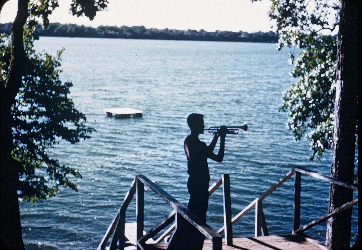 guy-playing-trumpet-by-lake